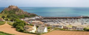 Mont Orgueil Castle panorama 300x120 - View to Mont Orgueil Castle with harbour in Gorey on Jersey, UK