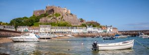 Mont Orgueil panorama 300x112 - Jersey, UK, may 15th 2011: Gorey harbour and Mont Orgueil Castle, Jersey, The Channel Islands